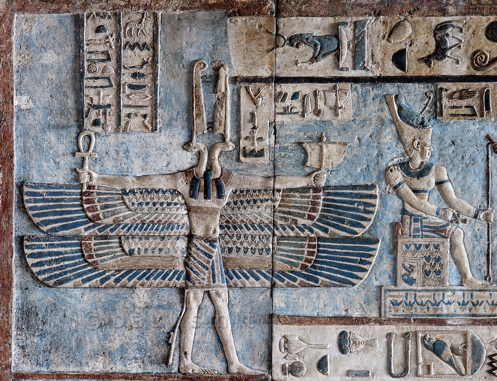 [EGYPT 29574]'West wind on astronomical ceiling at Dendera.' Holding a little sail in his hand, a double winged creature with two snake heads personifies the west wind on the astronomical ceiling in the outer hypostyle hall of the Hathor Temple at Dendera. Wind figures such as these only appear in Egyptian monuments of the Greek-Roman period.The astronomical ceiling consists of seven separate strips but here we are looking at a detail of the upper register of the SECOND STRIP WEST from centre.The enthroned god wearing the double crown of Upper and Lower Egypt is Atum, personification of the evening sun.An overview of the southern end of this ceiling strip can be found in picture 29572.For an overview of the entire astronomical ceiling see picture 29525.This part of the Dendera Temple was built during the Roman period (first century AD). Photo Paul Smit.