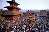 Nepal: New Year Festivals of Bhaktapur and Thimi : FEATURE (Category: Asia | Nepal | spring | festivals | cultural-historical | religion)..................REGISTER for LIGHTBOXNepal: New Year Festivals of Bhaktapur and ThimiNepal's New Year (Bisket) falls between the 12th and 15th of April and Bhaktapur's festival is a feast of colour, crowds, thrill and danger.  It starts with a tug-of-war in Taumadhi Square. Residents of the upper and lower halves of the city try to pull a huge chariot to their respective sides. This rath (vehicle of the gods) frequently smashes into temples and houses before it chooses its side.  For the New Year to take off a huge tree trunk has to be erected on Potter's Square. Lifting it without accident means the people of Bhaktapur will prosper in the New Year. But when it falls back into the crowd and people are killed - not a rare event - the year will be tough.  In neighbouring Thimi people throw clouds of vermilion  powder over their friends and neighbours, as a token of respect. Gods are carried through town in palanquins all night. They are too heavy for the shoulders, so people need to rotate, which is not without risks. Marihuana eases the pain as does the trance, created by the magical, slow drumming that impregnates everything.