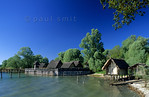 [GERMANY.BAWU 00720] 'Stone Age village.'  West African huts? Tahiti shore? Rather a German Stone Age lake-dwelling, reconstructed in the Pfahlbau open air museum in Unteruhldingen. Photo ...