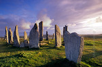 [BRITAIN.HEBRIDES 27669] ?Callanish seen from the north.?  On the Isle of Lewis the standing stones of the neolithic stone circle at Callanish bask in the evening sun. The circle has ...
