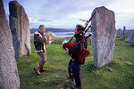 [BRITAIN.HEBRIDES 27673] ?Piping at Callanish stone circle.?  On a summer evening local musicians are enhancing the mystic atmosphere of the neolithic stone circle at Callanish on th ...