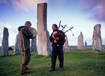 [BRITAIN.HEBRIDES 27672] ?Piping at Callanish stone circle.?  On a windy evening local musicians are enhancing the mystic atmosphere of the neolithic stone circle at Callanish on the ...